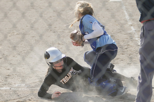 Record-Eagle/Keith King<br /> Traverse City Central's Eliza McCall (3) slides safely into home against Petoskey.