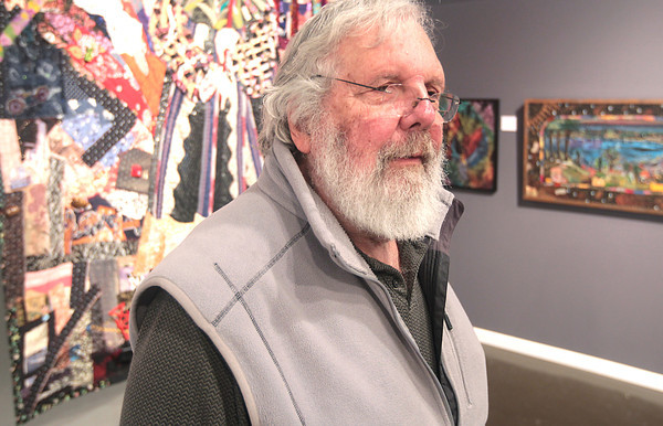 Record-Eagle/Nathan Payne<br /> Paul Welch stands in the midst of works of art from 30 years of Northwestern Michigan College students at the Traverse City Art & Design Studio.