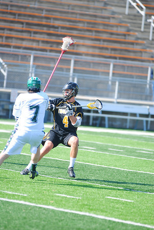 Record-Eagle/James Cook<br /> Traverse City Thunder's Brett Spanski (4) gets ready to unleash a shot Saturday at Thirlby Field against Muskegon Reeths-Puffer.