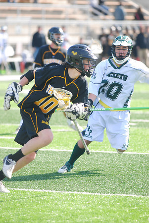 Record-Eagle/James Cook<br /> Traverse City Thunder's Chris Chang (10) attacks Saturday in a game against Muskegon Reeths-Puffer at Thirlby Field.