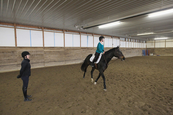 Record-Eagle/Keith King<br /> Emily Brinkman, left, instructor and trainer, gives pointers to Abby Gross, 13, and her horse, Tiger Lily, Tuesday, April 16, 2013 at Cold Spring Farm in Kasson Township.