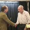Record-Eagle/Keith King<br /> Dr. John Richter, left, receives the Clarence Kroupa Award from Clarence Kroupa Friday, April 26, 2013 during the Northern Michigan Environmental Action Council (NMEAC) 25th annual Environmentalist of the Year Celebration at the Park Place Dome in Traverse City.