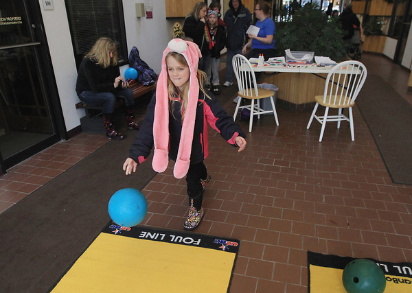 Record-Eagle/Keith King<br /> Sophie Schafer, 8, of Traverse City, throws a bowling ball Saturday, April 13, 2013 in downtown Traverse City as part of the 2nd annual Traverse Traveler Scavenger Hunt for Autism with money raised going toward the Traverse City Area Public Schools' iPads for Autism program.
