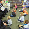 "Record-Eagle/Keith King<br /> Robert Cooney, Grand Traverse County Prosecutor, along with area child advocate leaders, government representatives and area law enforcement officials, reads a book called ""Police Officers on Patrol"" Wednesday, April 17, 2013 to Oak Park Elementary School Great Start Readiness Program (GSRP) students as part of the Fight Crime: Invest in Kids program."