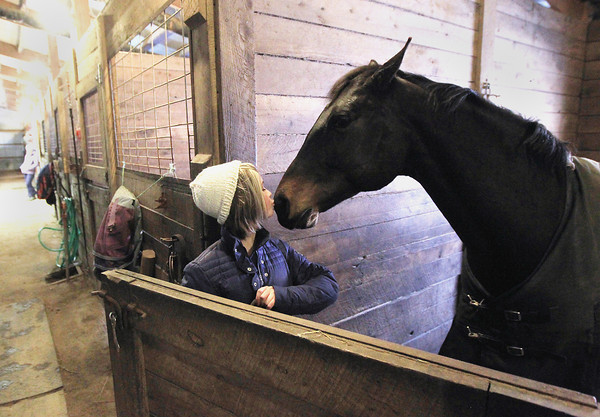 Record-Eagle/Keith King<br /> Abby Gross, 13, kisses her horse, Tiger Lily, Tuesday, April 16, 2013 prior to riding her at Cold Spring Farm in Kasson Township.