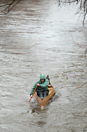 Record-Eagle/Keith King<br /> Nate Winkler, of Traverse City, paddles in the rain Thursday, April 18, 2013 on the Boardman River as he trains for the AuSable River Canoe Marathon. The race is scheduled to start on July 27.