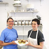 Record-Eagle/Mark Urban<br /> <br /> Potter's Bakery co-owner Kathy Potter, left, and kitchen manager Shannon Kiley hold the 'Meaty' sandwich in the new deli and event space at 908 E. Eighth St. Potter's will have a grand opening for the new addition to the business Saturday from 8 a.m. to 2 p.m.
