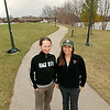 Record-Eagle/Keith King<br /> Arianne Whittaker, left, of Traverse City, and Lee Maynard, trail planner and program director at Traverse Area Recreation and Transportation (TART) Trails, Inc., stand on a trail near Boardman Lake. TART Trails Earth Day work place will be held Saturday. Whittaker plans on volunteering for the event.
