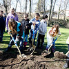Record-Eagle/Jan-Michael Stump<br /> Fourth graders in Pam McMurray's class at Central Grade School planted two trees in honor of Arbor Day on Friday morning in Hannah Park. They had help from Traverse City forester John Frasier.