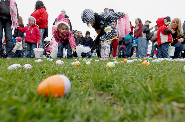 Record-Eagle/Jan-Michael Stump<br /> Zahra Stemlow, 3, left, and Juliette Hyde, 4, make note of which eggs they're going to grab once Saturday's Easter egg hunt begins at the Grand Traverse Civic Center. Hundreds of people turned out in chilly, overcast weather for the hunt. Thousands of candy-filled eggs were scattered in age group-designated areas, and an announcer's call sent mobs of basket, bag and bucket-carrying children to grab as many as they could.