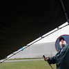Record-Eagle/Jan-Michael Stump<br /> Carl Schmidt Jr., of H.K. Enterprise in St. Ignance, raises a tent for a hats and sunglasses booth on Tuesday in preparation for the National Trout Festival at the Kalkaska County Fairgrounds.