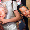 Record-Eagle/Jan-Michael Stump<br /> Amy Daniels Moehle, left, and Chris Daniels hold their Queen Elizabeth and Prince Charles masks as they arrive at the State Theatre early Friday morning.