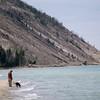 Record-Eagle Photo/Pete Rodman<br /> Robb Semple of Maple City walks along the shore of Lake Michigan with his dog Fletcher in Empire.