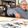 Record-Eagle/Nathan Payne<br /> Doug Weist sits at his drawing table inside his Traverse City home. Weist penned 24 images which hang in the Pro Football Hall of Fame in Canton, Ohio.