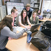 Record-Eagle/Keith King<br /> Kendra Benak, from left, Kaylee Niemi, editor-in-chief, Katelyn Patterson, advisor, Aaron Taylor and Maggie Harnish work on layouts in the Traverse City Central Senior High School yearbook class.