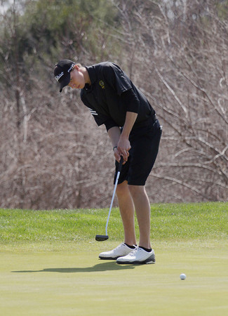 Record-Eagle/Keith King<br /> Traverse City Central's Winton Munch putts the ball Saturday, April 27, 2013 at the Grand Traverse Resort and Spa in Acme.