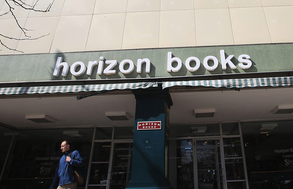 Record-Eagle/Keith King<br /> Marley Demers, of Benzonia, exits Horizon Books Thursday, April 25, 2013 in downtown Traverse City.