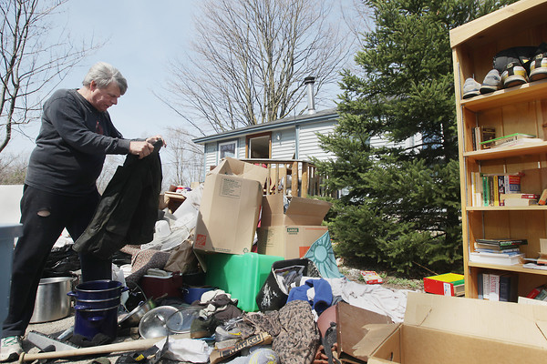 Record-Eagle/Keith King<br /> Robert Rienas, of Traverse City, sorts through his belongings Tuesday, April 30, 2013 after they were removed from the house due to foreclosure. Rienas lived in the house approximately 26 years.