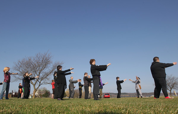 Record-Eagle/Keith King<br /> Master Sifu Jim Adkins, second from right, of White Tiger Martial Arts, leads attendees at the Open Space Saturday, April 27, 2013 during World Tai Chi and Qigong Day sponsored by White Tiger Martial Arts and the Northern Michigan Cultural Center.
