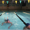 Record-Eagle/Keith King<br /> Paula Colombo, right, of Traverse City, talks with Grand Traverse Masters Swimming coach, Kathy Coffin-Sheard (not pictured), as Sean Cabbage, left, finishes swimming laps Saturday, April 27, 2013 in the Easling Pool at the Grand Traverse County Civic Center.