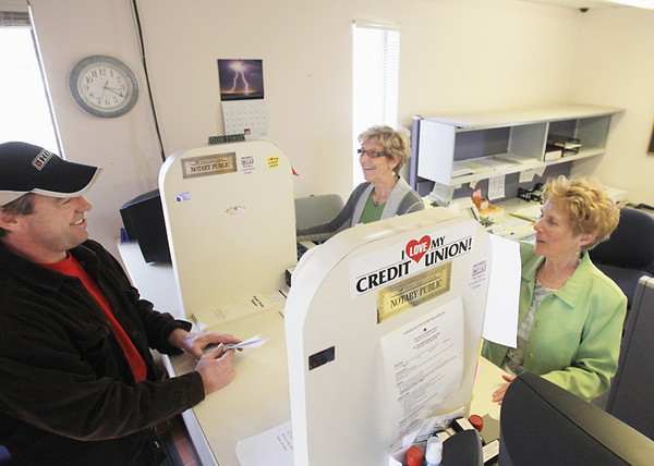Record-Eagle/Keith King<br /> David Saur, from left, talks with Dorie Rodes and Barbara Weber Wednesday, April 24, 2013 at the Cone Drive Gears Federal Credit Union in Traverse City.