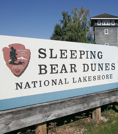 """Record-Eagle/Douglas Tesner<br /> <br /> Kerry Kelly and Friends of the Sleeping Bear Dunes are trying to get a Sleeping Bear Dunes license plate. They also have a sticker they sell """"Got Sand?"""" as a fundraiser to support projects in the Sleeping Bear Park."""