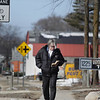 "Record-Eagle/Keith King<br /> Russell Byers, of Traverse City, walks along Woodmere Avenue as he reads a book he checked out from the Traverse Area District Library. ""I just like reading,"" Russell said."