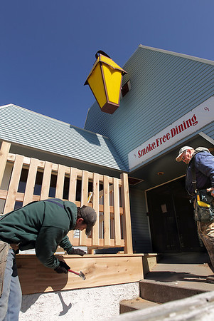 Record-Eagle/Keith King<br /> Joe Dell, left, and Dale Williams, work on a deck Tuesday at the Flap Jack Shack, which has been purchased by Restaurant Partners Inc.