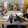 Record-Eagle/Keith King<br /> Northwestern Michigan College Great Lakes Maritime Academy cadets Mary Kate Rea, right, of California, and Will Thompson, of New Hampshire, study at the Traverse Area District Library.