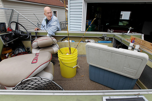 "Record-Eagle/Keith King<br /> Jack Armour, of Traverse City, prepares his boat Wednesday, April 6, 2011 after it had been stored for the winter. Armour, along with his wife, returned from Orlando, FL Tuesday, April 5, 2011 where they spend the winter working for Disney. ""It's the best of both worlds,"" Armour said about his summers spent in Traverse City and his winters spent in Florida. He plans on going fishing for lake trout and whitefish in West Grand Traverse Bay Thursday morning. ""Tomorrow I'm going to wake up, eat breakfast and go fishing,"" Armour said. ""Usually an old timer will drive by and we'll shoot the bull-lie to each other,"" Armour said."