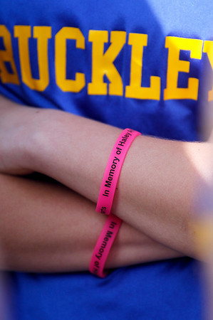 Record-Eagle/Jan-Michael Stump<br /> The Buckley High School student council is selling wristbands to remember Haley Baldinger and assist the Baldinger family with expenses. A number of runners wore the bracelets during Thursday's track meet with Manton and McBain NMC.