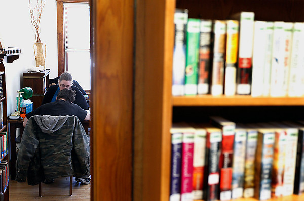 Record-Eagle/Jan-Michael Stump<br /> Roy Currie and Kimberly Evans use the Catton Room at the Benzonia Public Library for their weekly Project Read meeting.