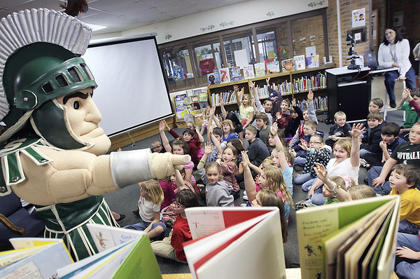 Record-Eagle/Keith King<br /> Michigan State University mascot Sparty visits Westwoods Elementary School on Friday to promote reading. Sparty was also scheduled to visit Cherry Knoll Elementary School and Traverse City Area Public Schools' Montessori at Glen Loomis.