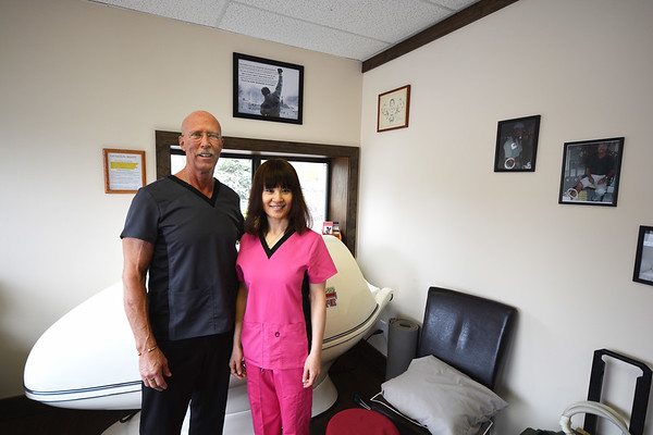 Record-Eagle/Dan Nielsen<br /> David Burke and Baorong Mitchell co-own Kaya's Massage, 508 West 14th Street, in Hickory Corners shopping center. Behind them is a personal sauna device.