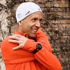 Record-Eagle/Pete Rodman<br /> Matt Johnston stretches before embarking on a Boston Marathon training run on the TART trail near his employer West Bay Exploration on Bay Shore Drive.