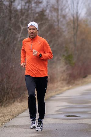 Record-Eagle/Pete Rodman<br /> Matt Johnston on a Boston Marathon training run on the TART trail.