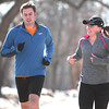 Record-Eagle/Nathan Payne<br /> Brent and Kaitlyn Malaski run along Washington Street on Tuesday while training for the upcoming Boston Marathon. The married couple earned entry into this year's race together while running in last year's Bayshore Marathon.