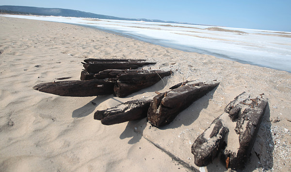 Record-Eagle/Nathan Payne<br /> The ribs of a shipwreck jut from the sand on the Lake Michigan shoreline north of Glen Arbor. About 40-feet of a wooden boat frame was uncovered by winter storms and left exposed on the beach when winter ice began to recede recently.