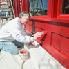 "Record-Eagle/Keith King<br /> Bill Koch, with Easling Construction, paints the exterior of Red Ginger Wednesday in downtown Traverse City. ""Patience and a good brush,"" Koch says he uses when painting edges."