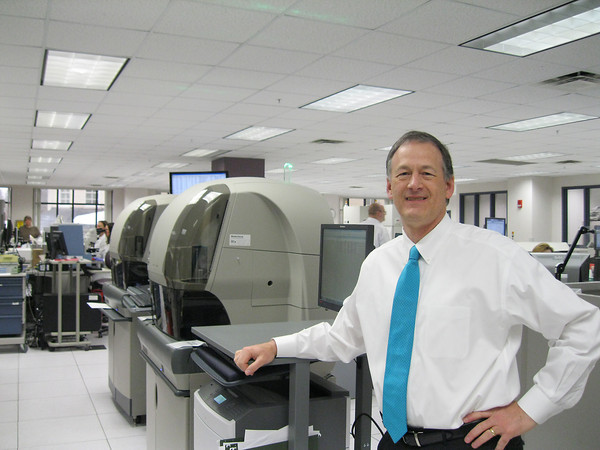 Record-Eagle/Carol Thompson<br /> Munson Healthcare's laboratory medical director Dr. John Keep stands in Munson's laboratory, where samples for genetic tests are processed and sent to the Mayo Clinic.