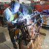 Record-Eagle/Keith King<br /> Keith Newstead welds a tailgate at Stromberg Carlson Products Inc. in Traverse City.