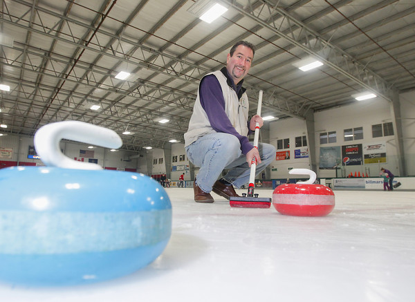 Record-Eagle/Keith King<br /> Don Piche, of Traverse City, holds a curling broom near curling stones Tuesday at Centre ICE Arena in Traverse City. Piche is spearheading an effort to bring curling to Traverse City. A curling open house including demonstrations, instruction, the opportunity to try curling and a number of state curling clubs participating, is planned for April 26 presented by the Traverse City Curling Club, from 9:00 a.m. until 6:00 p.m., at Centre ICE Arena. For information or questions visit Facebook.com/tccurling or call (231)218-3076.