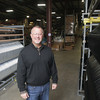 Record-Eagle/Keith King<br /> Bob Brammer Jr., president, stands at Stromberg Carlson Products Inc. in Traverse City.