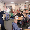 Record-Eagle/Keith King<br /> Ross Machiela, from left, Fifth Third Bank associate portfolio manager, and Steve Haskin, Fifth Third Bank portfolio manager, in partnership with Junior Achievement of Northwest Michigan, discuss financial literacy Wednesday, April 3, 2013 with students at Blair Elementary School.