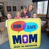 Record-Eagle/Keith King<br /> Sadie Smith, from left, 7, Izzy Smith, 9, Bernie Smith, 5, Missy Smith, mother, and Lucy Smith, 7, all of Traverse City, pose Friday, March 22, 2013 at their home. Missy is the founder of Gun Safe Mom. Smith's brother, Jeffrey Carson, was shot and killed in 1986 by a classmate while playing at the classmate's house.