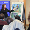 Record-Eagle/Keith King<br /> Carrie Thompson, left, Bay Area Transportation Authority (BATA) business development director, and Doug Dowdy, BATA transportation services manager, talk Thursday, April 4, 2013 at Disability Network/ Northern Michigan in Traverse City.