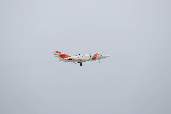 Record-Eagle/Keith King<br /> A United States Coast Guard HU-25 Falcon jet performs a flyover near a runway at the Cherry Capital Airport Thursday, April 11, 2013 prior to landing at U.S.C.G. Air Station Traverse City. The jet, which flew from U.S.C.G. Air Station Cape Cod, will be retired with plans for it to be displayed.