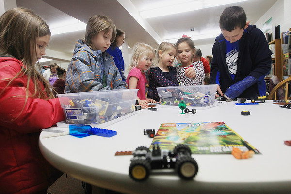 "Record-Eagle/Keith King<br /> London Birgy, from left, 5, Beck Birgy, 7, Addie Gelinas, 4, McKenna Gelinas, 5, Annie Ponstein, 7 and Tyler Guggemos, 8, all of Kalkaska, play with Legos Wednesday, April 10, 2013 during the Lego-Rama event at the Kalkaska County Library. A ""Star Wars""-themed Lego event is scheduled for Saturday, May 4 at 1:00 p.m. titled ""May the Fourth Be With You,"" at the library with trivia and prizes planned. Costumes are also encouraged for the event."