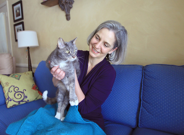 Record-Eagle/Keith King<br /> Lori Fasi, of Traverse City, sits with her cat, Maximus, Friday, April 12, 2013 at her home in Traverse City.