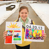 Record-Eagle/Keith King<br /> Emily Decker, 15, a member of the Traverse City Central High School Student Senate, co-organizer, along with Niki Roxbury, 15, also with student senate, holds posters at Traverse City Central High School Friday, April 12, 2013 for the Spring Splatter 5K scheduled for April 20, 2013 at Traverse City Central High School to benefit the Traverse Bay Children's Advocacy Center.